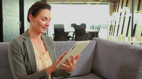 Businesswoman using tablet Live Action