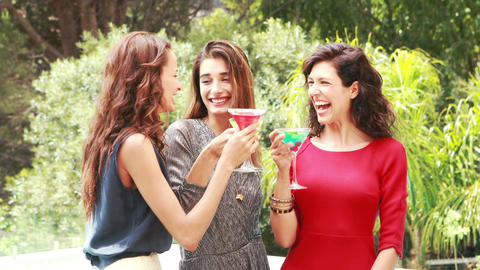 Attractive women having a drink outdoor Live Action