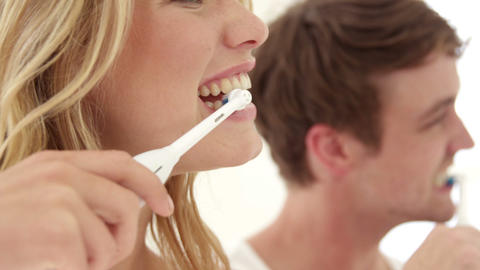 Couple wash their teeth with electronic toothbrush Live Action