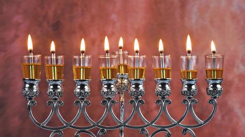 Jewish holiday olive oil Hanukah candles celebrating the menorah Live Action