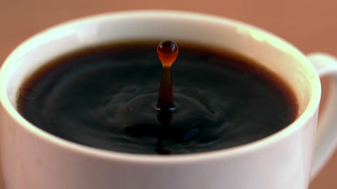 Drop falling into cup of coffee in cinemagraph Live Action