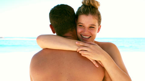 Couple hugging on the beach Live Action