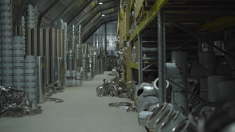 Metal production warehouse. Steel metal pipes and metal items stored in freight Live Action