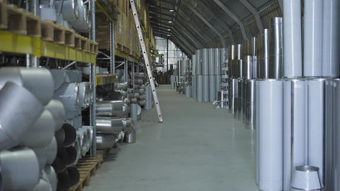 Warehouse with metal ready production. Steel metal pipes stored in freight Live Action