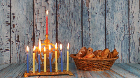 Menorah with burning candles and donuts, Hanukkah Holidays Live Action