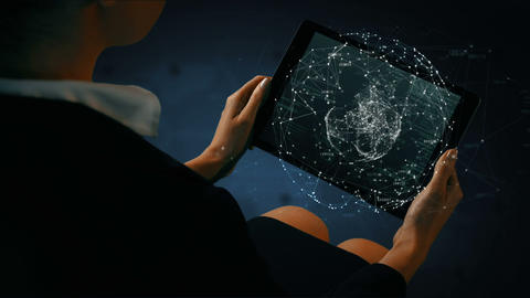 Businesswoman using tablet with digital animation Live Action