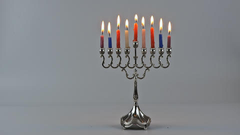 Eight candles in hanukkiah are burning on the seventh day of the Jewish holiday Live Action