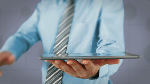 Businessman using tablet with digital animation Live Action