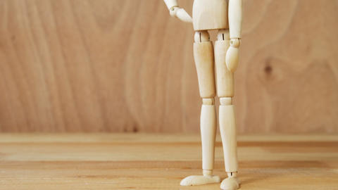 Figurine standing with hands on hip Live Action