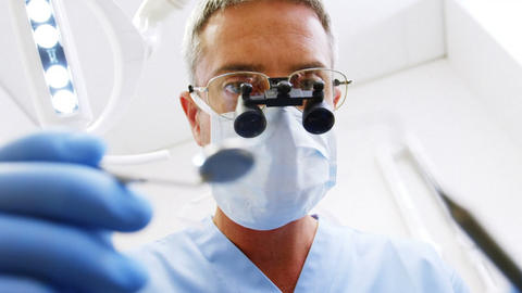Dentist holding dental tool Live Action