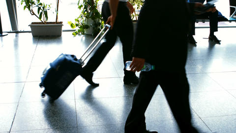 Commuters walking with their luggage Live Action