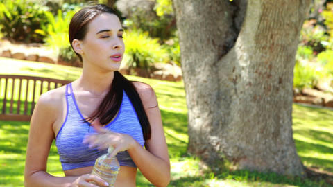 Woman drinking water from water bottle Live Action