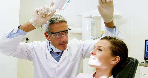 Dentist examining a patient Live Action