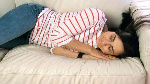 Woman falling asleep on the couch in living room Live Action