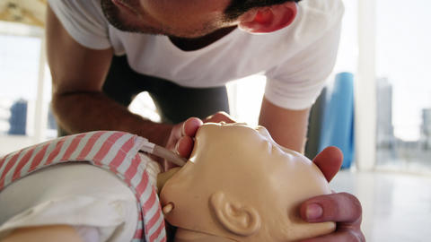 Male paramedic during cardiopulmonary resuscitation training Live Action