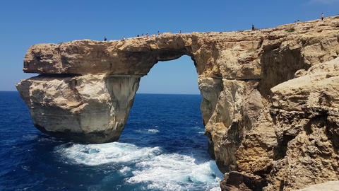 Gozo Island, Malta - 03 August 2016: Tourists climbing on The Azure Window Footage