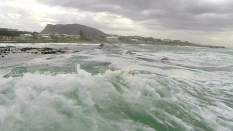 Motor boat entering rough sea on the coast of South Africa Footage