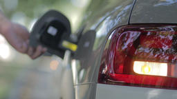 Woman opening car gas tank cap Footage