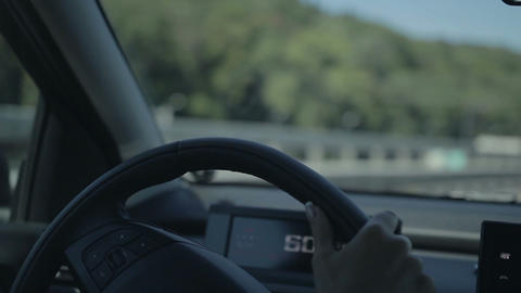 Young woman driving car and making a turn Footage