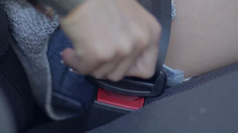 close up of female fastening safety belt in car Live Action