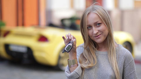 Young smiling woman holding keys to new car Footage