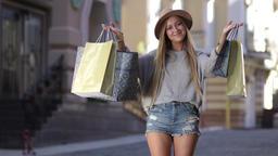 Shopaholic woman holding many shopping bags Footage