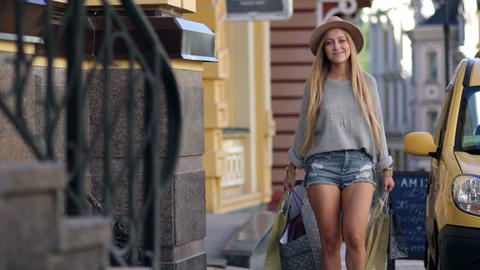 Elegant woman carrying shopping bags and smiling Footage