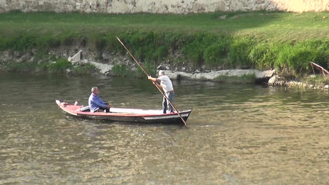 The men go boating on Arno river in Florence, Italy Footage