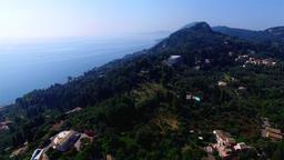 Flying aerial Corfu village countryside ocean sea coast Greece 4k video Footage