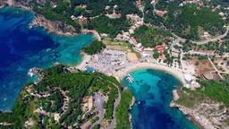 Flight aerial Paleokastritsa bay Greece Corfu 4k video. Ocean sea coast beach Footage