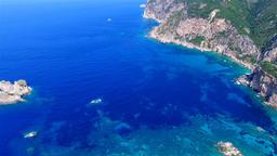 Flight aerial Paleokastritsa bay Greece Corfu HD video. Village sea rocky coast Footage