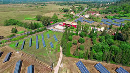 Solar power panels ECO alternative energy HD aerial video. Sun farm Footage