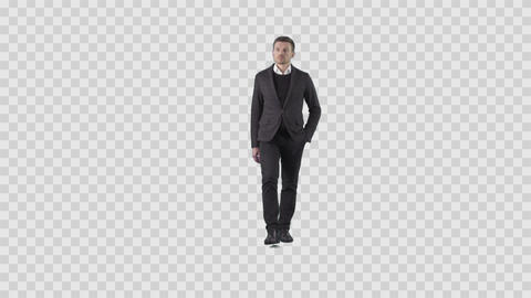 Attractive young businessman is walking at the camera. Transparent background Live Action