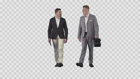 Two men in business clothes are going together at the camera. Alpha channel Footage