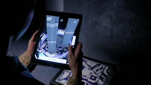 Woman using digital tablet with architecture augmented reality app Live Action