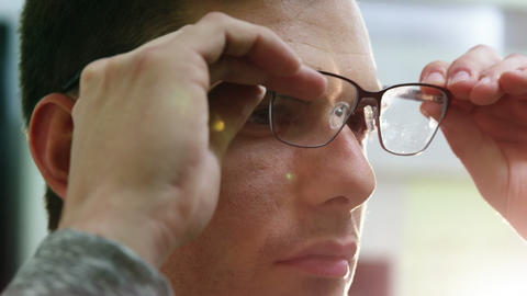 Close-up of customer trying spectacles Live Action