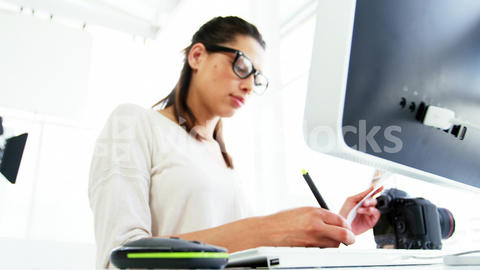Graphic designer using a graphics tablet Live-Action