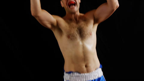 Excited male boxer posing after victory Live Action