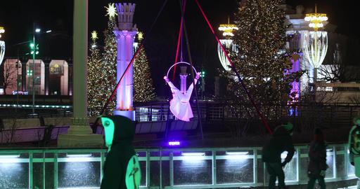 Skating rink visitors and acrobat Live Action