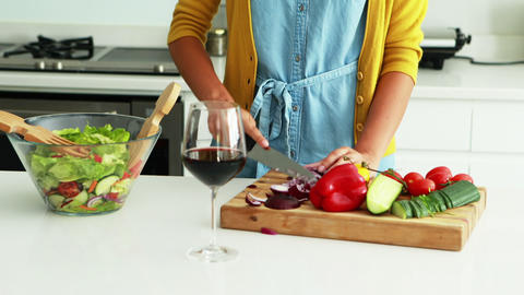 Man embracing woman in the kitchen while preparing a salad in kitchen Live Action