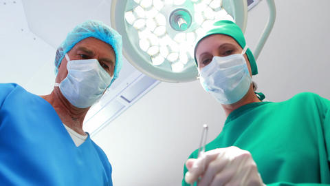 Surgeons performing operation in operation theater Live Action