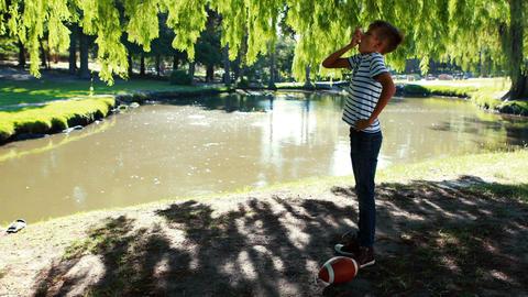 Boy using asthma inhaler in park Live Action