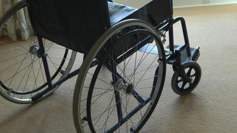 Empty wheelchair in bedroom Live Action