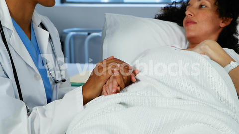 Doctor comforting pregnant woman in ward Live Action
