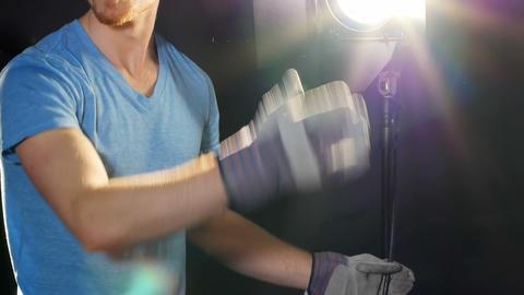 Male photographer adjusting flashlight during shoot Live Action