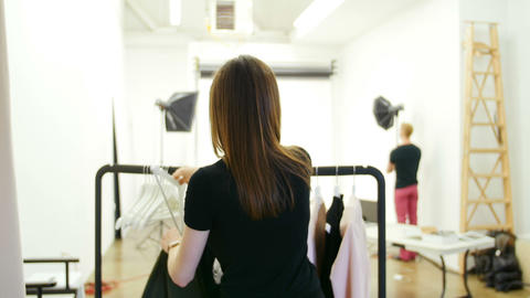 Female model trying apparel during photo shoot Live Action