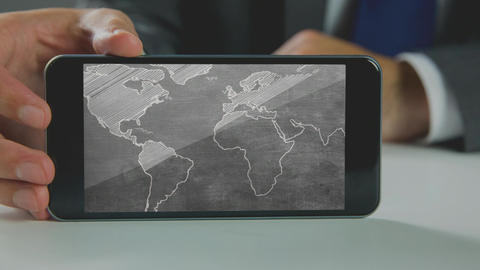 Digital generated video of businessman holding mobile phone with world map 4k Animation