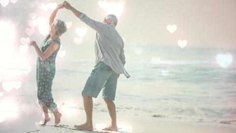 Happy retired elders dancing on the beach with hearts animation for valentine day Animation