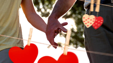 Couple holding hand on a sunny day with hearts for valentine day Animation