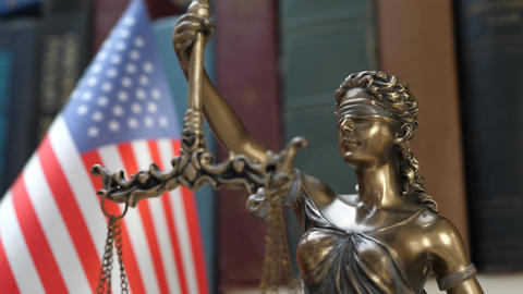 Lady Justice Symbol with USA Flag and Bookshelf Background Live Action